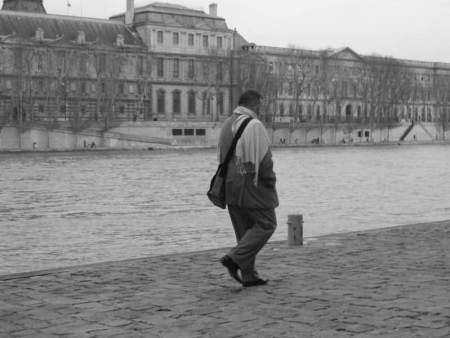 Paris City Photo - Black and White - Man walking on Les Quais de la Seine