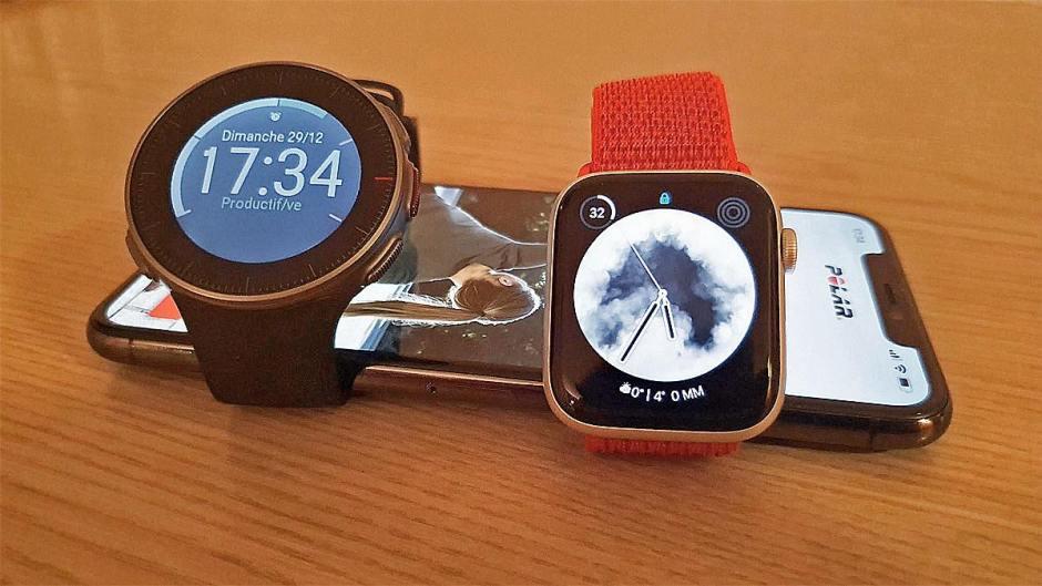 La Polar Vantage V et l'Apple Watch series 5 avec un iPhone 11 Pro Max.