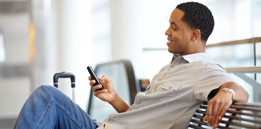 Man using smartphone airport