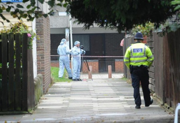 Forensic officers at the scene where the Nigerian music promoter was murdered