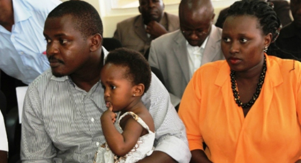 Eric Kamanzi, his wife, Angela, and baby Arnella at the police headquarters. Photo: Kenneth Kazibwe