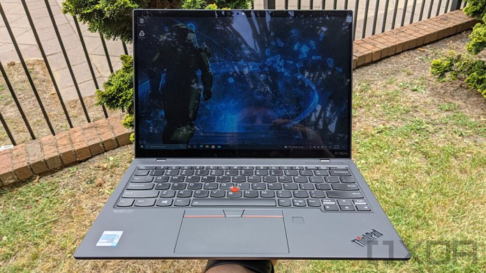 Front view of Lenovo ThinkPad X1 Nano in one hand