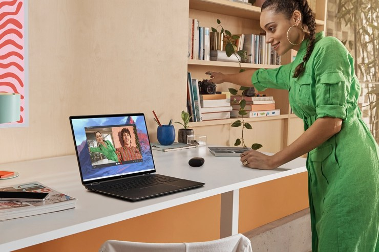 Woman standing in front of HP Spectre x360 16