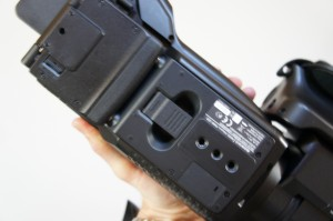 The release catch for the shoulder pad on the underside of the PMW-300 camera.