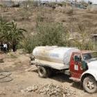 Los comerciantes de agua en pipas reportan lentitud para cargar en los pozos