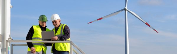 Technicians engaged in the detecting of a wind turbine installation for the production of energy