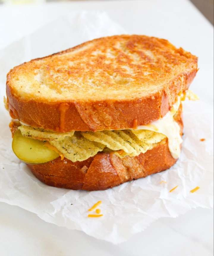 a grilled cheese sandwich on a white background