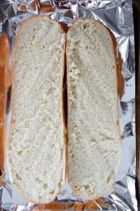 a loaf of French bread cut in half lengthwise