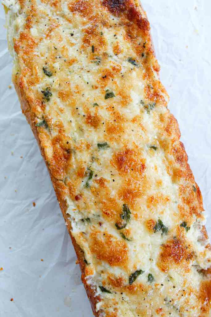 a close up of garlic cheese bread on a white background