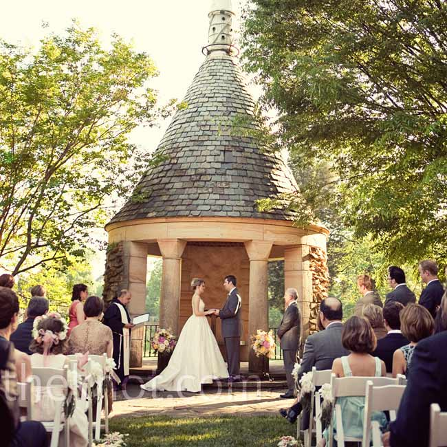 "The bride and groom said ""I do"" at sunset, in a stone gazebo in the Graylyn's White Garden."
