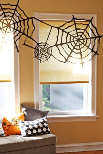 diy decor for halloween trash bags spiders web