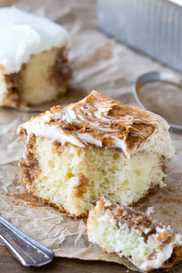Cinnamon Roll Poke Cake | Poke Cakes make a foolproof, easy dessert every time. These poke cake recipes are quick and easy cakes that you need to try. It's a brilliant way to make delicious desserts every time because most of these poke cake recipe starts with simple store-bought ingredients, you see all the time and probably have in your kitchen already! #xokatierosario #pokecakerecipes #easypokecakerecipes #quickcakerecipes