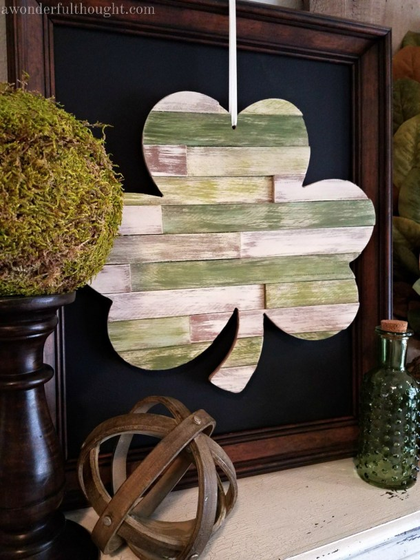 DIY Wood Shim Shamrock | These adorable St. Patrick's Day decorations are perfect for a weekend of celebrating the lucky holiday. These DIY decorations will fit a great with your farmhouse rustic home decor while being festive at the same time! Choose from St. Patrick's inspired tablescapes, DIY signs, shamrock garlands or mini banners that work in desserts and centerpieces! #xokatierosario #stpatrickdaydecor #stpatricksdaydiycrafts #farmhousehomedecor