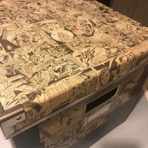 ...although the IKEA box that Jay decoupaged those strips onto does look pretty damned cool.