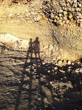 shadow portrait of two women on a rock