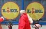 BERLIN - DECEMBER 29: A man walks past a branc...