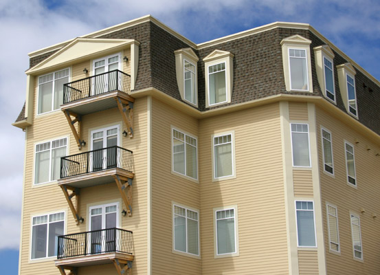 beautiful mansard roofing upscale apartment building