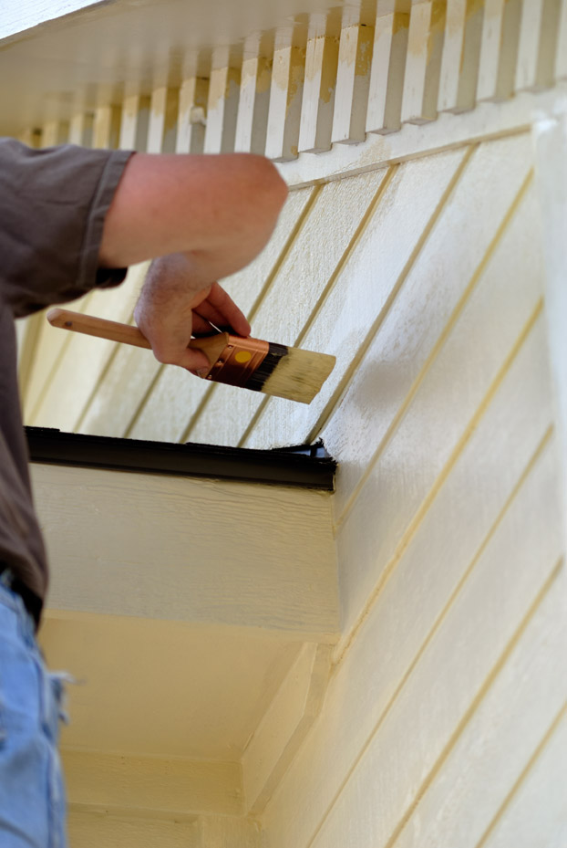 contractor painting home exterior