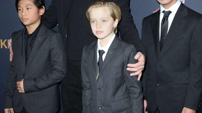 why does shiloh pitt dress like a boy