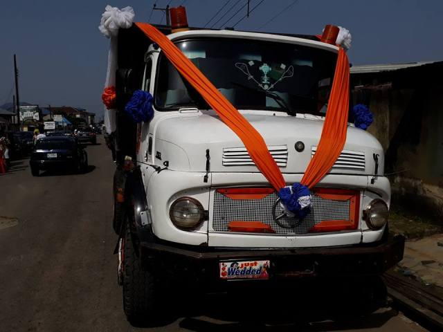Okon 0 - Newly wed couple use a tipper to transport themselves after their wedding