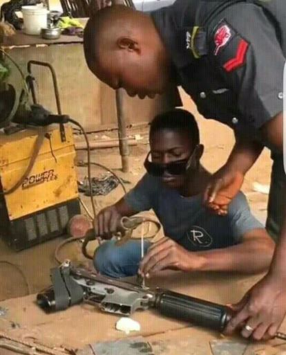 Nigerian Policeman Fixing
