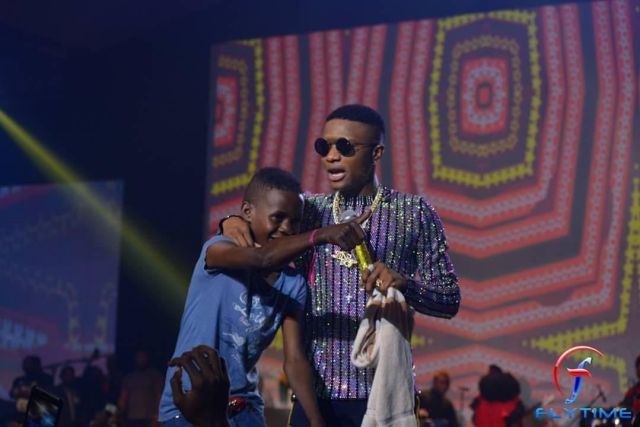 Wizkid signs 12 year old boy