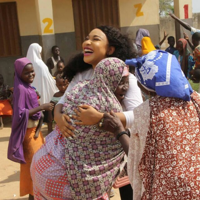 tonto dikeh and crippled1 - Tonto Dikeh All Smiles As She Visits Physically Challenged People In Abuja.