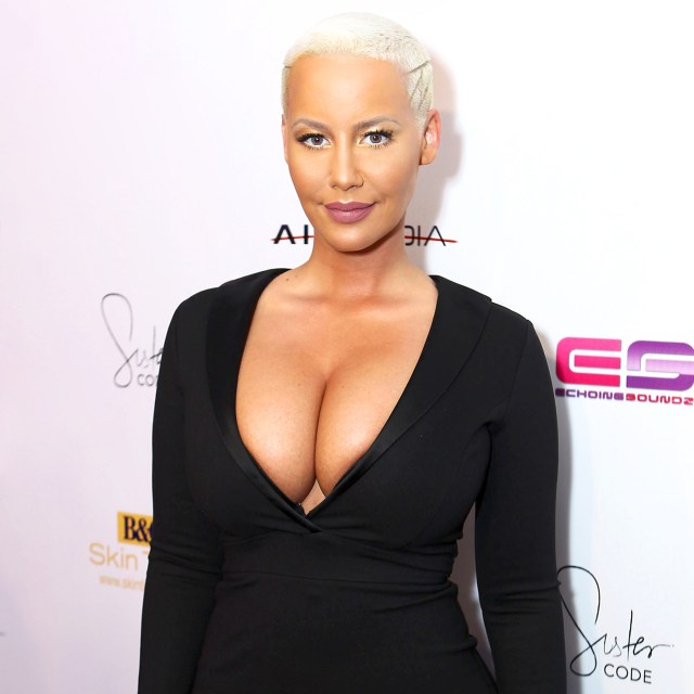 Amber Rose show off smaller b-oobs after her reduction surgery ( Photos)
