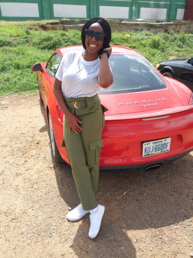 Photos: Female Corps member steps out with a Porsche for clearance in Abuja - Image ~ Naijabang