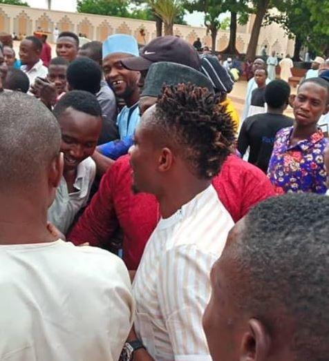 Football fans mob Ahmed Musa