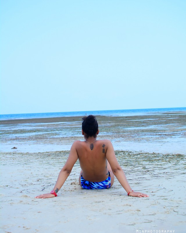 TBoss goes topless as she hits the beach + Video of her trying to twerk