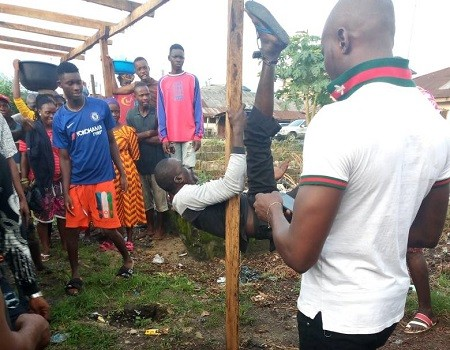 Middle-aged man tied to a stake gets beating of his life by angry youths for raping 7-year-old girl in Warri