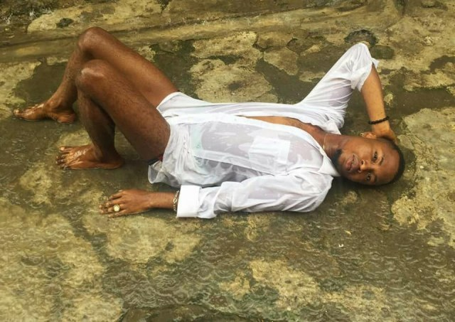 Nigerian man strikes suggestive poses on wet floor