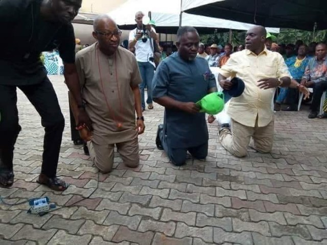 Patrick Obahiagbon kneeling
