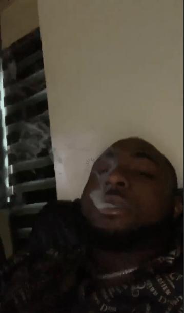 Davido seen smoking