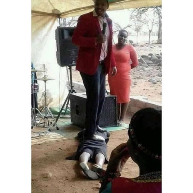 SA pastor stand on - (Photo) South African pastor performs miracle by stepping on member's buttocks