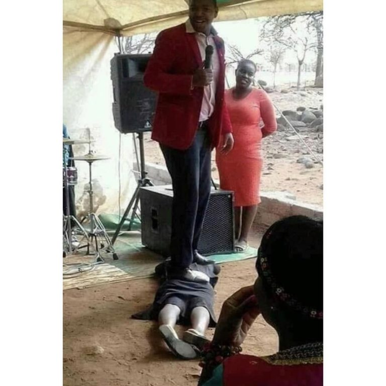 South African Pastor Performs Miracle By Stepping On Member's Buttocks (Photo)