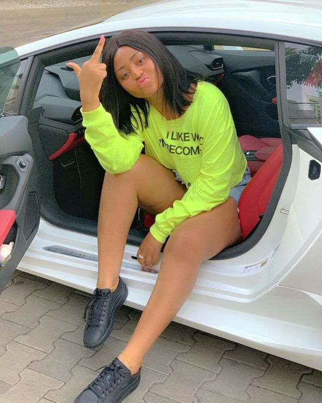 Regina Daniels serves haters #FvckU sign as she rides in a Lamborghini