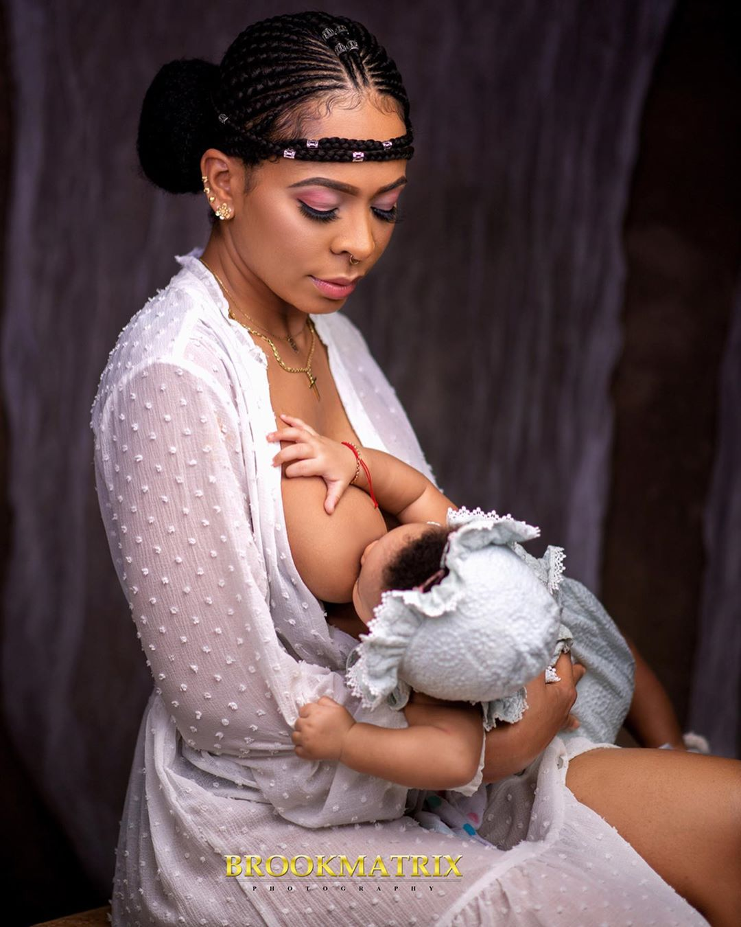 Proud Mother, Tboss 'breastfeeds' her daughter in new adorable photos