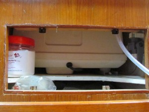 Access hole for the watermaker and to let out heat. Also handy for storing the pickling and cleaning chemicals