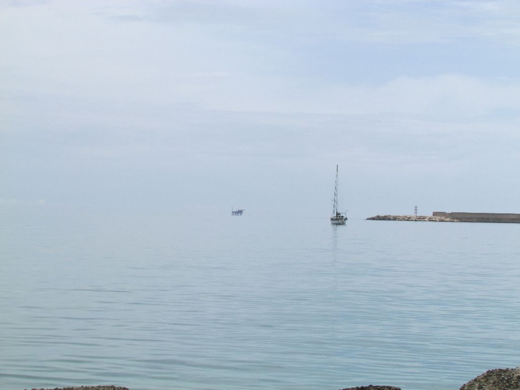 A lot of grey. Emerald in the north anchorage at Crotone
