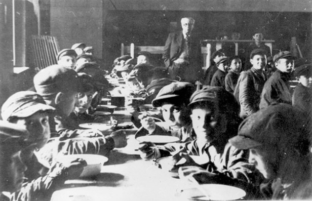 Children receiving a meal at one of the study halls in the Siauliai Ghetto