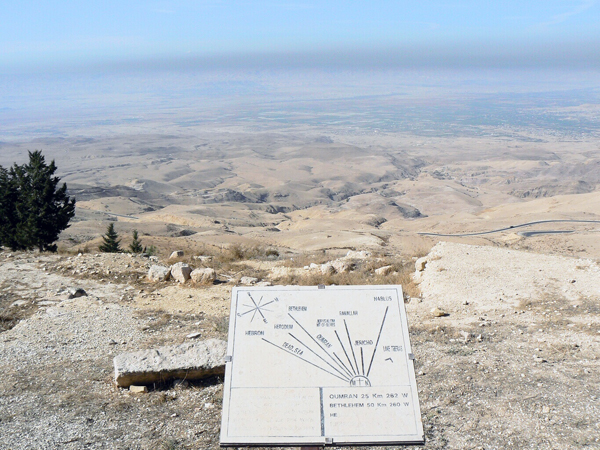 view from Mt. Nebo - sign points to places in the near distance: Hebron, Dead Sea, Herodium, Bethlehem, Qumran, Jerusalem, Ramallah, Jericho, Nablus