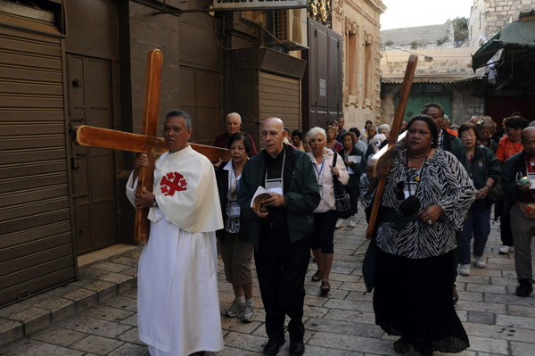 walking the Via Dolorosa in the Old City of Jerusalem