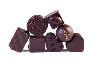 Handcrafted, organic, Fair Trade chocolate truffles and creams, available at Pure Lovin' Chocolate. $22/dozen
