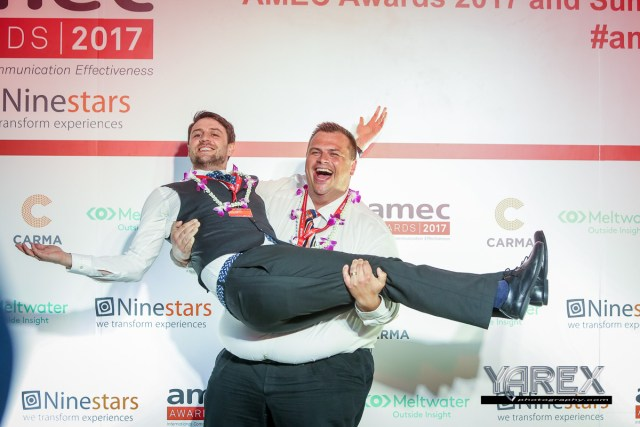 happy winners celebrating at a conference awards dinner