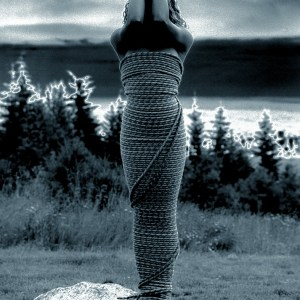 Statuesque Girl wrapped in Rope
