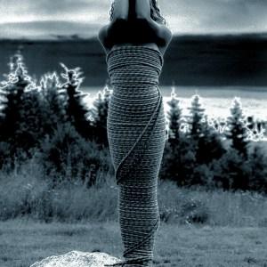 Dark Skined Girl wrapped in Rope