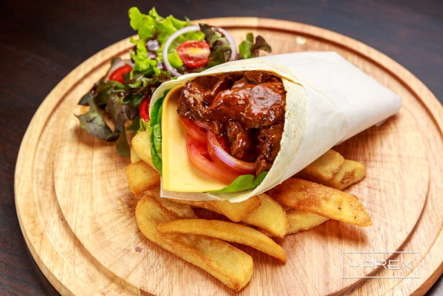 Food Photography at O'Malley's Restaurant - Beef Wrap on a table. Bangkok, Thailand