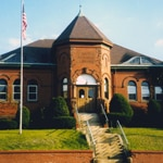 The Shute library in Everett, MA has been closed for four years for extensive renovations.  This tiny image is the only one I could find on the library's website depicting the pre-renovation appearance of the library.  The refurbished library was scheduled to reopen this past weekend.  The library's construction blog includes many wonderful pictures of the renovation process: http://shutelibrary.org